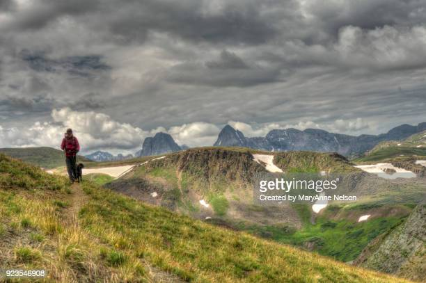 Hiker, Dog, Continental Divide Trail and Mountains