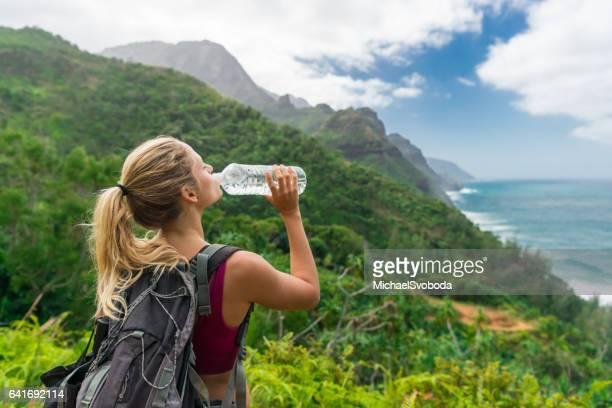 Hiker Drinking Water In The Beauty