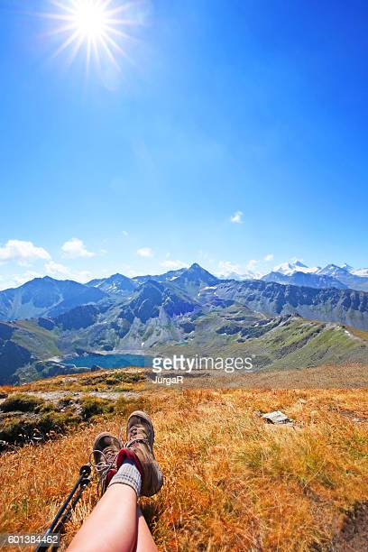Hiker Enjoying the View in the Swiss Mountains in Summer