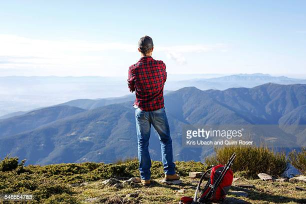 Hiker enjoying view from hilltop, Montseny, Barcelona, Catalonia, Spain