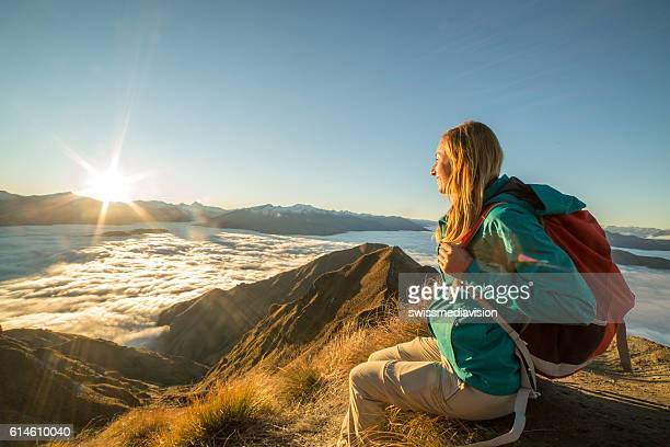 Hiker enjoying view from mountain summit
