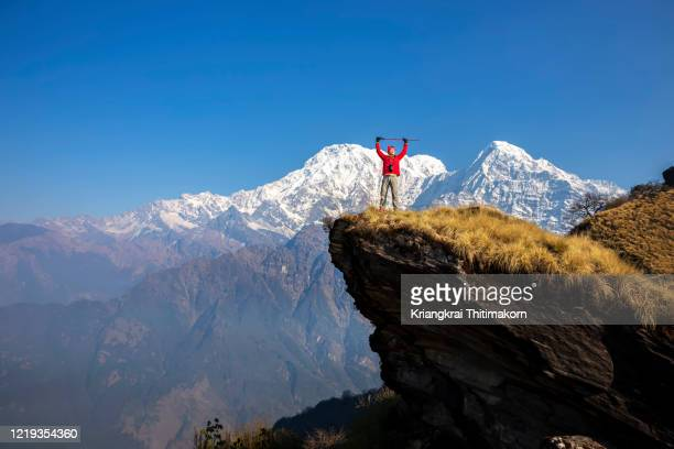 hiker enjoys the view of himalaya mountains in nepal. - annapurna south stock pictures, royalty-free photos & images