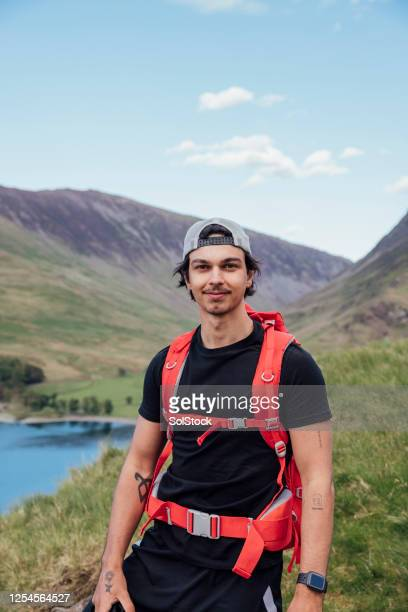 hiker exploring cumbria - 20 24 years stock pictures, royalty-free photos & images