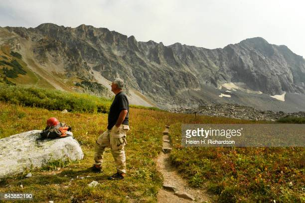 WILDERNESS CO SEPTEMBER 6 Hiker George Nick looks towards the decent trail as he waits for his climbing partner to return near Capitol Lake with the...