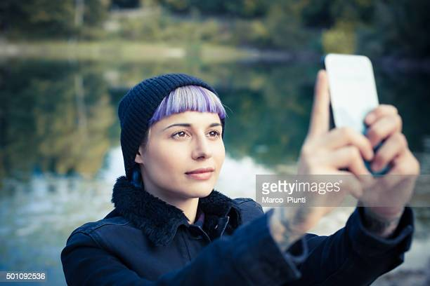 hiker girl using smartphone at the mountain - vanity stock pictures, royalty-free photos & images