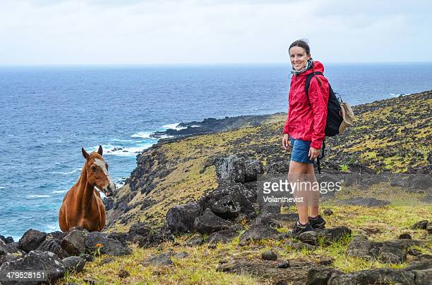 Hiker girl w/ backpack and a horse, Easter Island