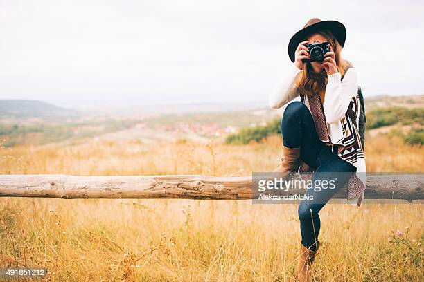Hiker girl with a camera