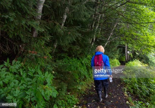 Hiker in Alaska rainforest