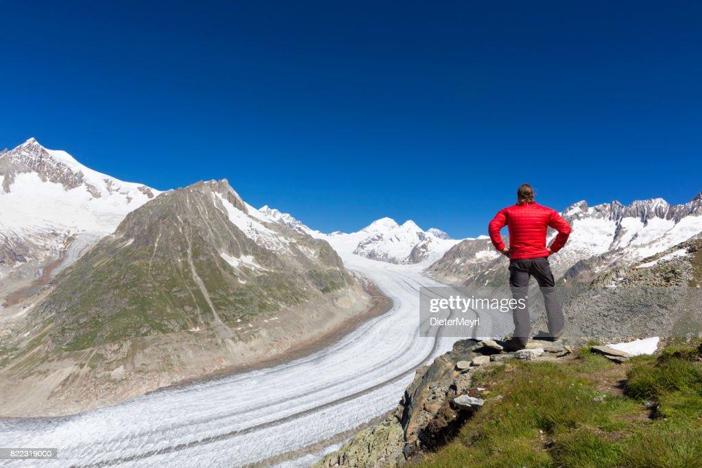 Hiker in front of Aletschgletscher : Stock Photo