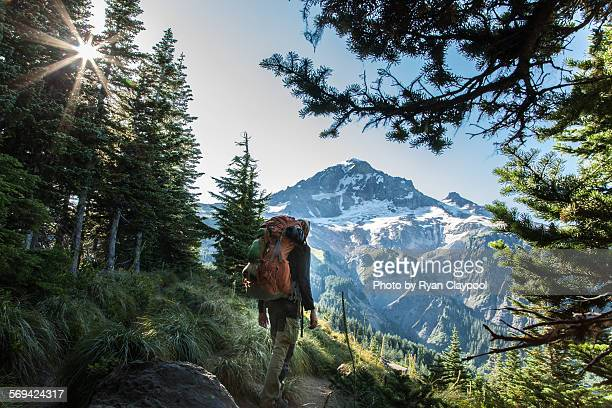 a hiker in front of mt. hood in the early morning - snapping the ball stock pictures, royalty-free photos & images