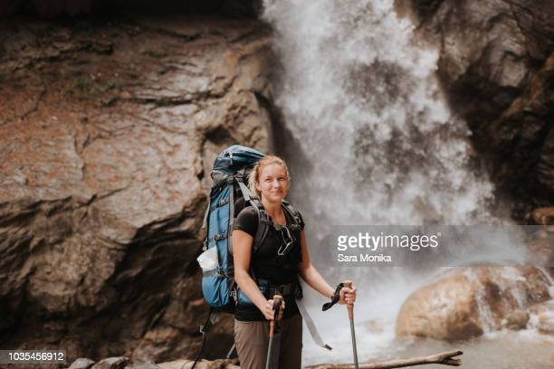 Hiker in front of waterfall, Annapurna Circuit, the Himalayas, Manang, Nepal