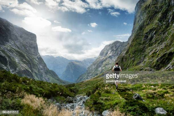 hiker in the landscape of the southern alps in new zealand - new zealand stock pictures, royalty-free photos & images