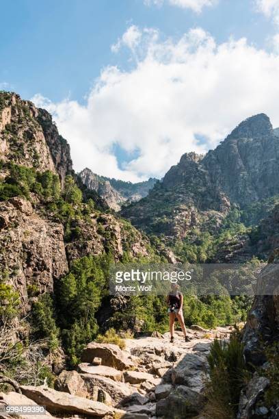hiker in the mountains, refuge de carrozzu, corsica, france - corsica stock photos and pictures