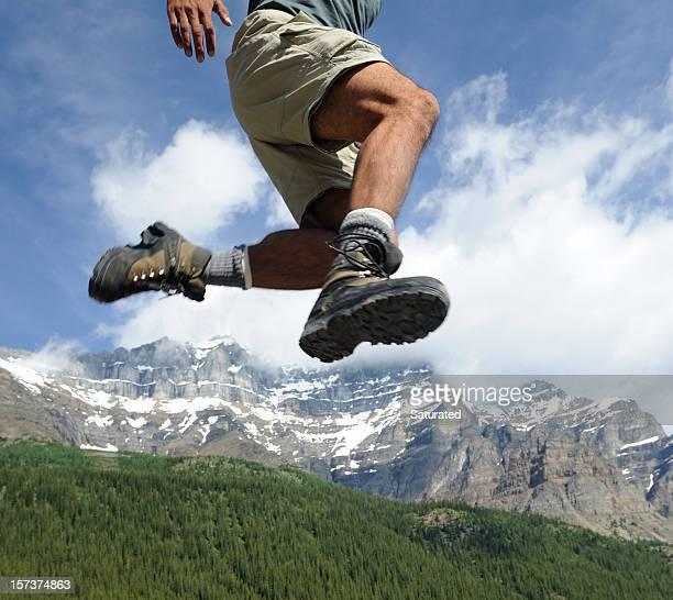 Hiker Jumping Through the Air