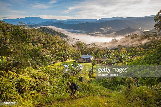 a hiker leaves nauro village, kokoda trail - papua new guinea stock pictures, royalty-free photos & images