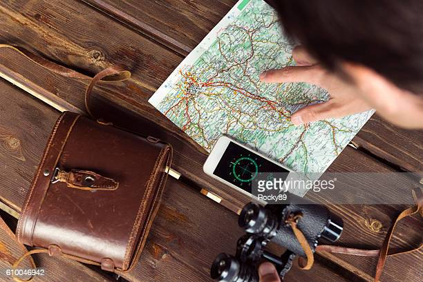 hiker looking at his map - cartography stock photos and pictures
