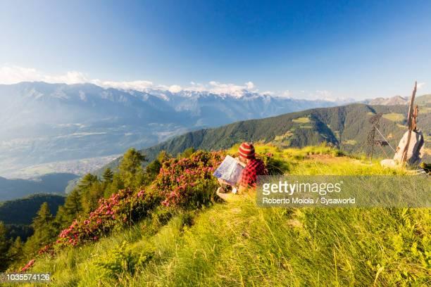 Hiker looking at map, Orobie Alps