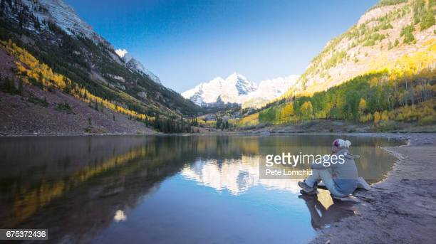 hiker looking at maroon bell mountain colorado - maroon bells stock photos and pictures