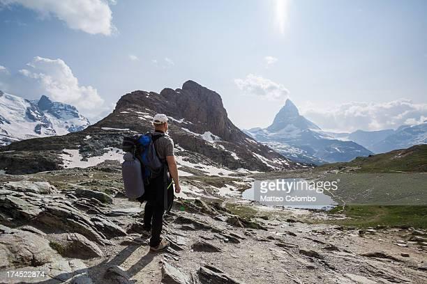 Hiker looking at Matterhorn mountain in summer