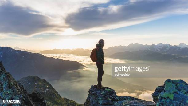 Hiker looking at mountain range
