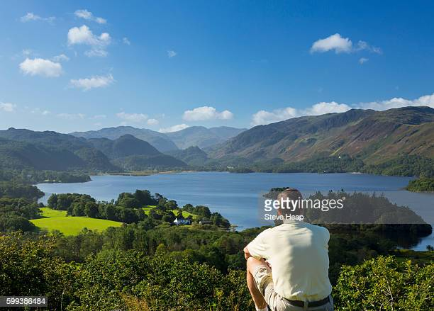 hiker looking at panorama of derwentwater in english lake district, england, uk from castlehead viewpoint in early morning - derwent water - fotografias e filmes do acervo