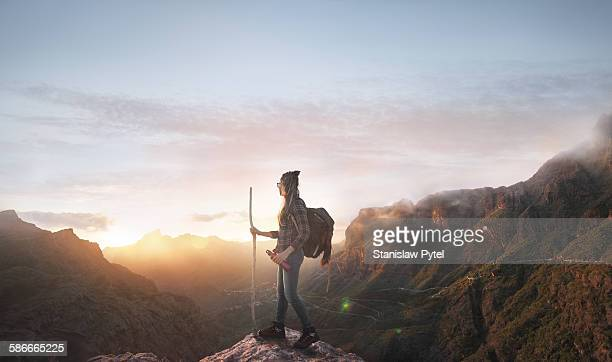 Hiker looking at sunset in mountains