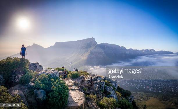 hiker looking at table mountain - cape town stock pictures, royalty-free photos & images