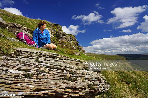 Hiker looking at the view across the Black Mountains in the Brecon Beacons national park in Wales in Heredfordshire.