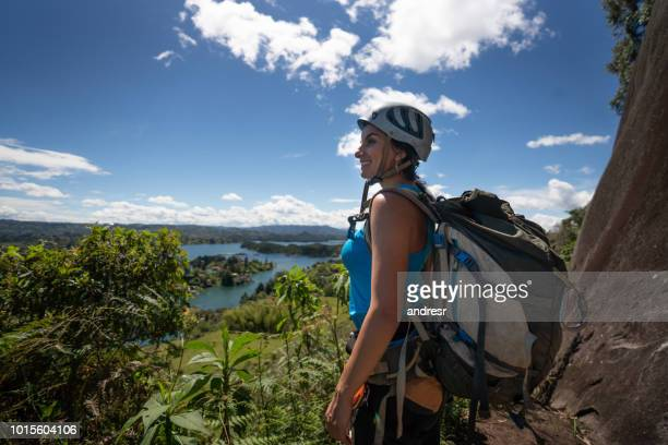 hiker looking at the view from a cliff - guatapé stock pictures, royalty-free photos & images
