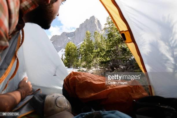 Hiker looking at view through tent at Grand Teton National Park