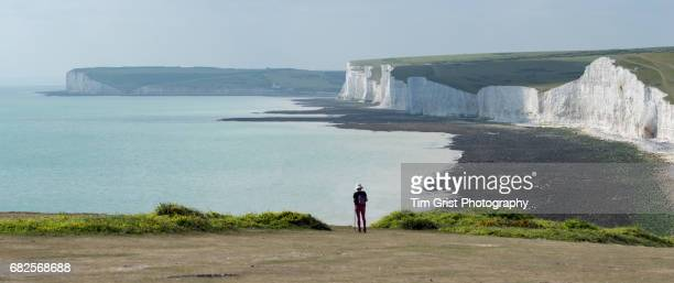 Hiker Looking out along The Seven Sisters Cliffs