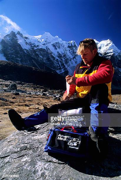 hiker looking through medical kit - first aid kit stock pictures, royalty-free photos & images
