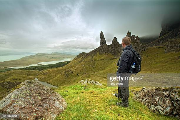 Hiker looks out over classic Skye view