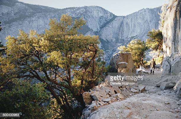 Hiker makes his way down the Four-Mile Trail from Glacier Point in Yosemite National Park, California.