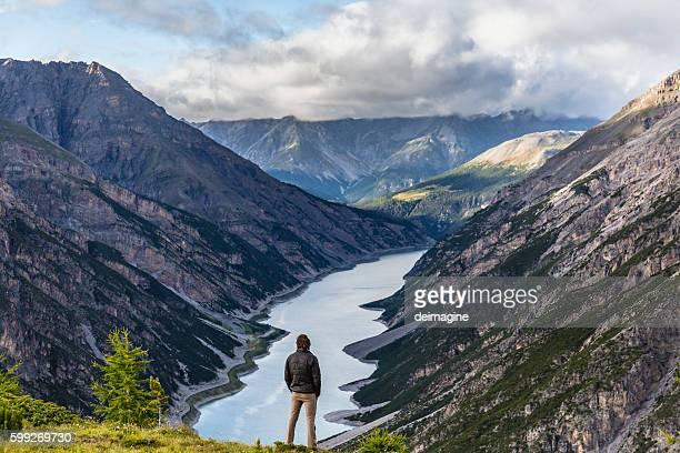 Hiker man enjoy lake mountain view