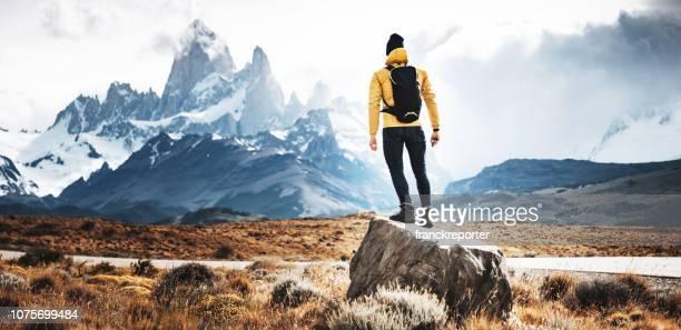 hiker man standing in el chalten - chalten stock pictures, royalty-free photos & images
