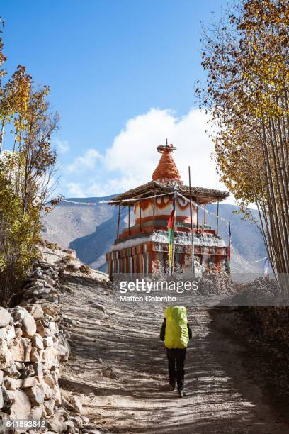 Hiker near small stupa, Upper Mustang region, Nepal