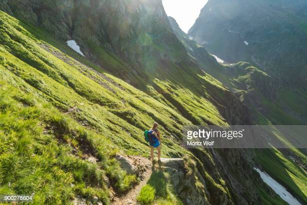 hiker on a trail in the sunshine, schladming trail, hiking trail to hochgolling, schladming tauern, schladming, styria, austria - schladming stock pictures, royalty-free photos & images