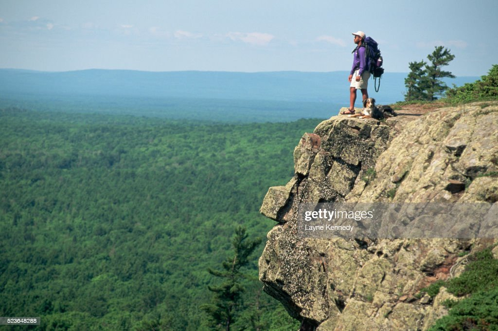 Hiker on Cliff Above Valley : ストックフォト