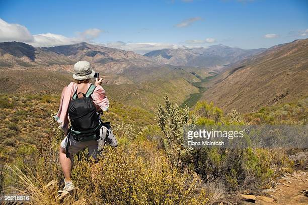 hiker on donkey trail looking out towards gamkaskloof, karoo, western cape province, south africa - the karoo stock pictures, royalty-free photos & images