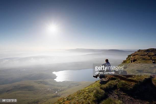 hiker on fan foel overlooking llyn y fan fawr - brecon beacons stock pictures, royalty-free photos & images