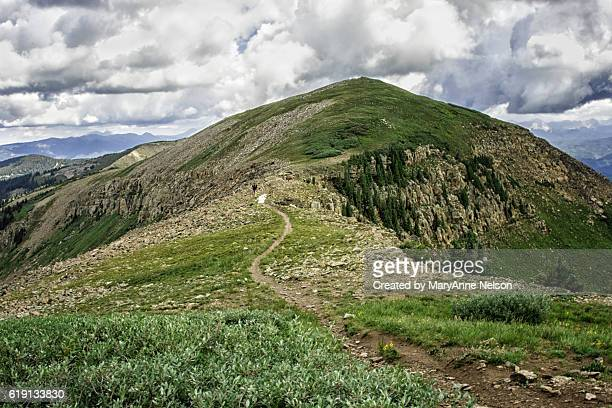 hiker on indian ridge trail in mountains - mountain ridge stock pictures, royalty-free photos & images
