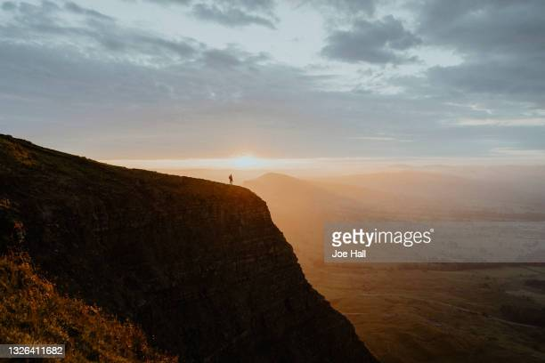 hiker on mountain peak, peak district national park, england - distant stock pictures, royalty-free photos & images