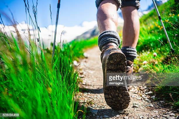 hiker on mountain trail - ankle boot stock photos and pictures
