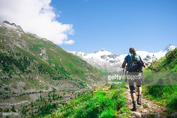 Hiker on mountain trail
