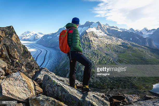 Hiker on mountains enjoy panorama view