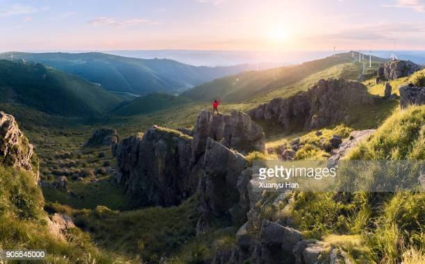 hiker on mountains enjoy sunrise - sunrise mountain peak stock pictures, royalty-free photos & images