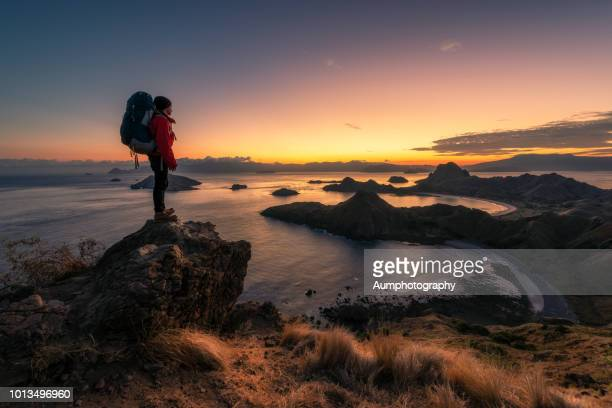 hiker on mountains of padar island,komodo national park, indonesia. - flores indonesia fotografías e imágenes de stock