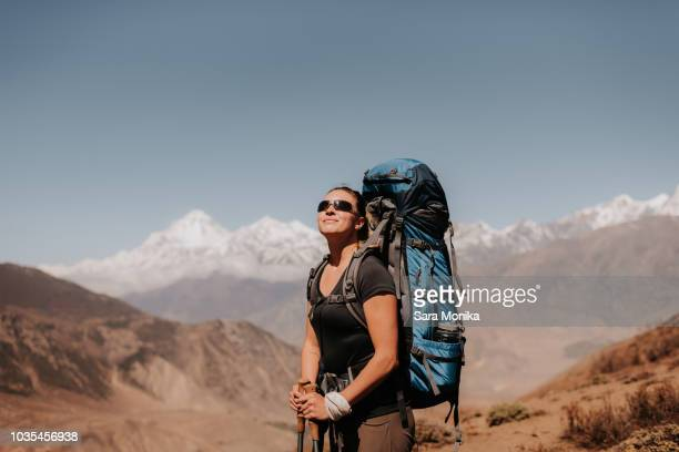 Hiker on peak, Annapurna Circuit, the Himalayas,  Dhaulagiri and Tukuche mountains in background, Muktinath, Nepal