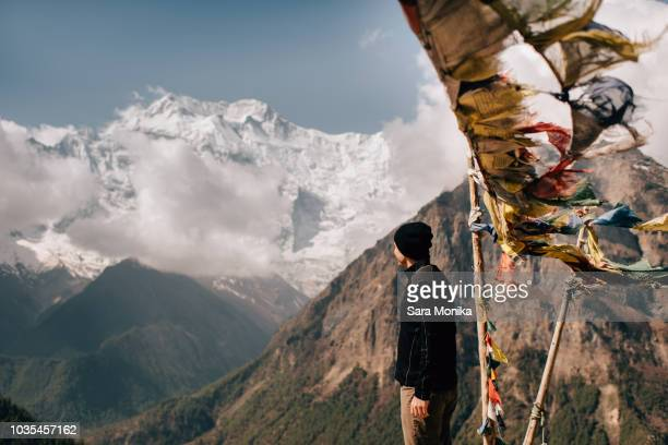 Hiker on peak, Annapurna Circuit,  view to Annapurna 2 mountain, the Himalayas, Manang, Nepal